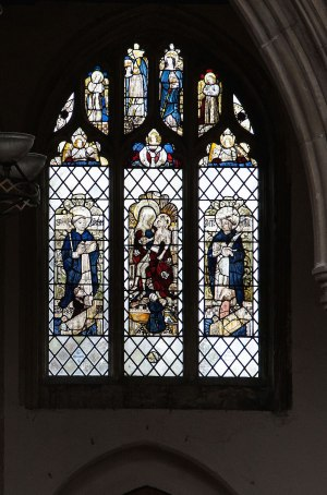 Window above north aisle door with small 'Three Hares' roundel centred beneath the Pietà